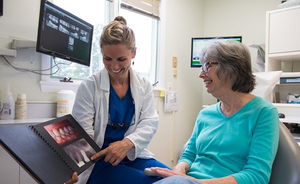 A Lyme Road Dental team member smiling with a patient