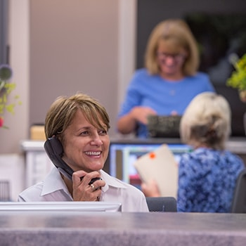 Dana talking to a patient over the phone