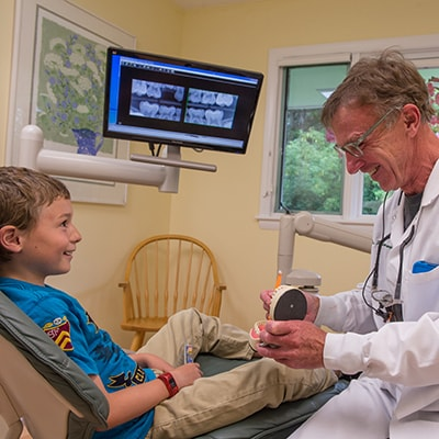 Family Dentistry Hanover, NH - Dr. Wonsavage talking about sealants with a kiddo patient