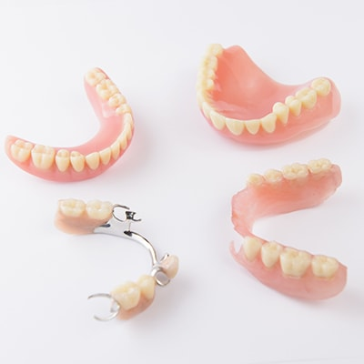 Pieces of partial and full dentures