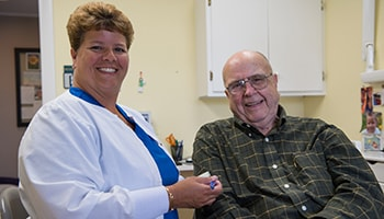 A team member smiling with a patient