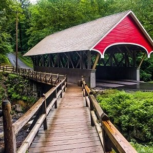 Red covered bridge in New Hampshire countryside