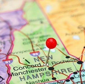 Map of New Hampshire with a pin in capitol city of Concord.
